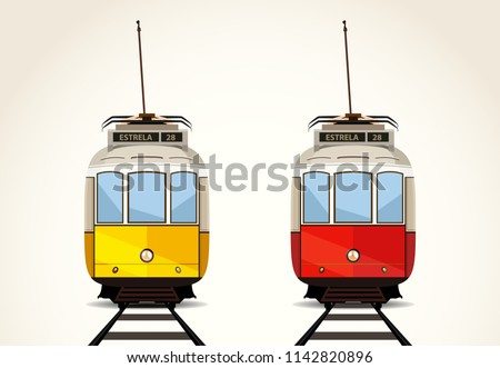 Old Lisbon isolated trams on the railway. Yellow and red electric trams.