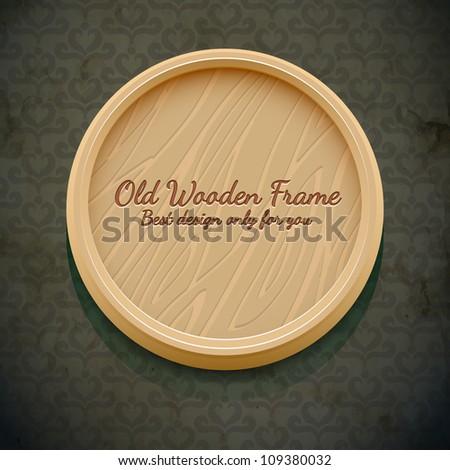 Old wooden frame on dark wallpaper