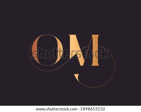 OM monogram logo.Abstract calligraphic signature icon.Letter o and letter m.Lettering sign isolated on dark background.Alphabet initials.Metallic gold uppercase wedding characters and swirl element. Foto stock ©
