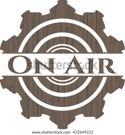 On Air badge with wood background
