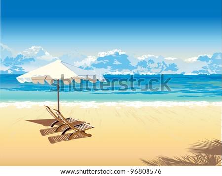 on the beach under an umbrella