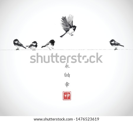 One bird flying and four little birds sitting on a wire. Traditional oriental ink painting sumi-e, u-sin, go-hua on white background. Hieroglyphs - eternity, freedom, happiness, spirit