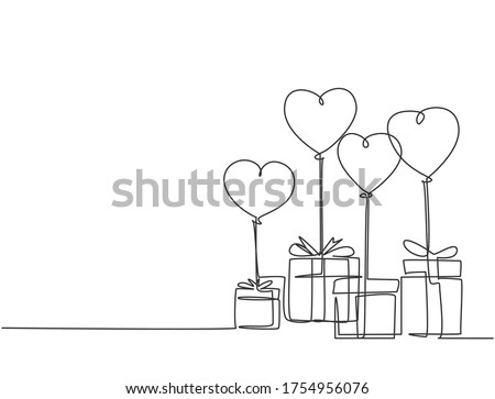 One continuous line drawing of cute gifts box tied with ribbon tape and flying heart shaped gas balloon. Romantic marriage proposal gift concept single line draw design graphic vector illustration Foto stock ©