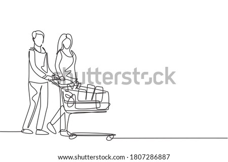 One continuous line drawing young happy romantic couple pushing trolley full of daily goods, vegetables, fruits, milk together. Shopping in grocery store concept. Single line draw design illustration