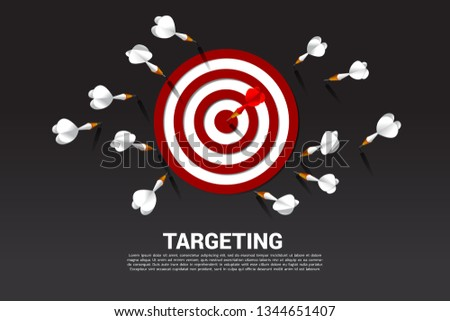 one of dart arrow hit the center of dartboard . Business Concept of missing the marketing target and customer.success on company mission and goal.