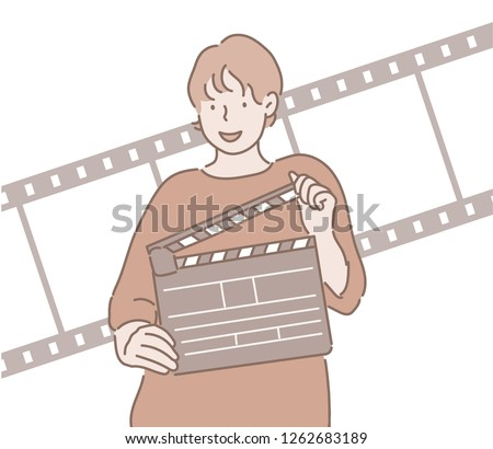 One person is holding a clapper board and smiling. hand drawn style vector design illustrations.