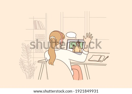 Online education, distant learning during pandemic concept. Homeschool girl student sitting backwards greeting teacher during virtual internet online class during coronavirus epidemic and lockdown