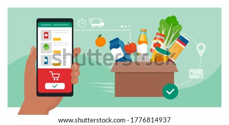 Online grocery shopping: user ordering groceries online using a mobile app, box with fresh food in the background, food delivery concept Foto stock ©