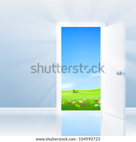 Open door concept. Door opens to a beautiful lush field under a blue sky.