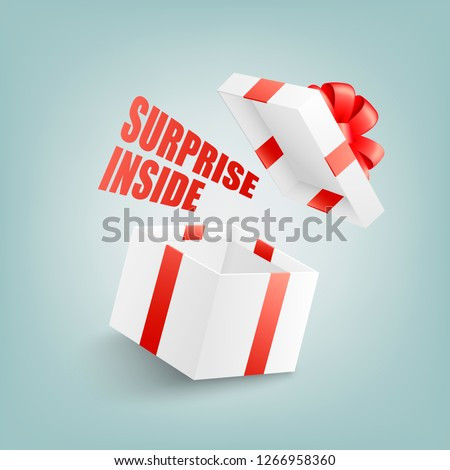 Open white gift box with red ribbon and bow, flying cover and sign Surprise Inside in realistic 3d style isolated on blue background - greeting present package in vector illustration.