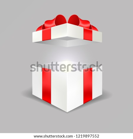 Opened white gift box empty angle front view 3D with red bow and lights isolated in gray background easy to replace for your design and logo. Realistic blank Package free gifts banner