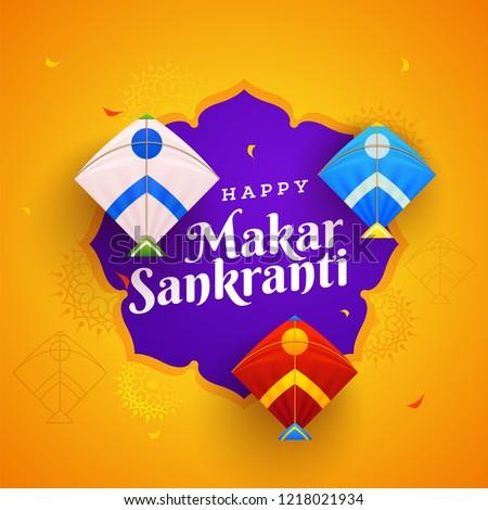Orange floral background decorated with colorful kites for Happy Makar Sankranti festival celebration.