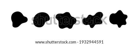Organic black blobs irregular shape. Abstract fluid shapes vector set, simple water forms