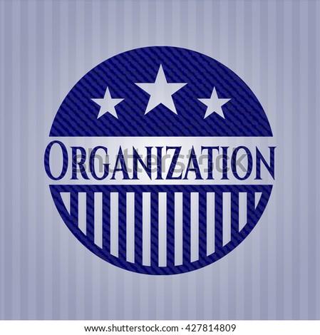 Organization badge with denim texture