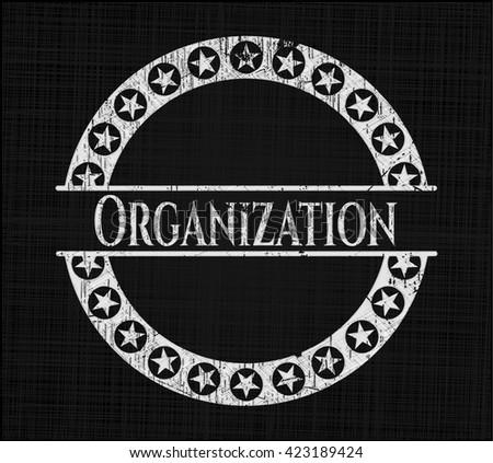 Organization chalk emblem written on a blackboard