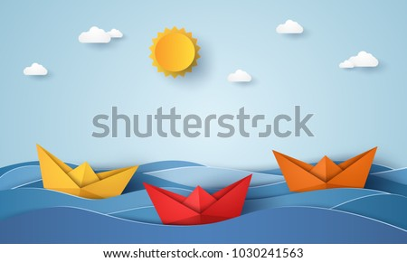 origami boat sailing in blue