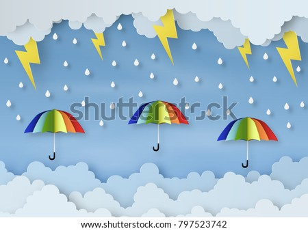 Origami made rainy weather forecast of Water drop on the colorful umbrella and thunder in the sky, paper art design and craft style.