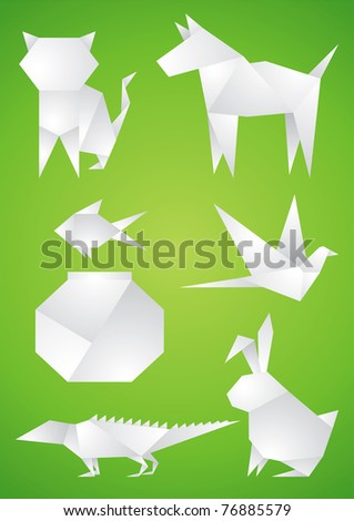 Origami Pets of the white paper on green background