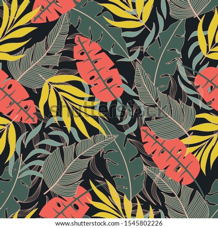 Original seamless tropical pattern in bright colors on a dark background. Beautiful exotic plants.  Exotic jungle wallpaper. Trendy summer Hawaii print.