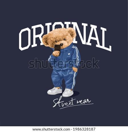 original street wear slogan with cartoon bear doll in track suit taking selfie vector illustration