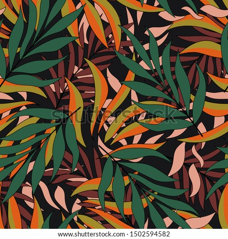 Original tropical seamless pattern with exotic plants and leaves on a dark background. Beautiful exotic plants. Beautiful exotic plants. Beautiful print. Colorful stylish floral.