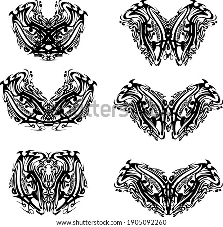 Ornate butterfly wings in black and white tones. Unusual abstract butterflies on a white background for cards, textile, tattoo, embroidery, decorative compositions, etc.
