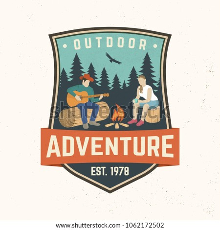 Outdoor adventure badge. Vector illustration. Concept for shirt or print, stamp, travel badge or tee. Vintage typography design with camper tent, pot on the fire, axe and mountain silhouette.