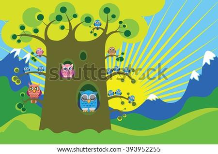 owl and owlets on big tree