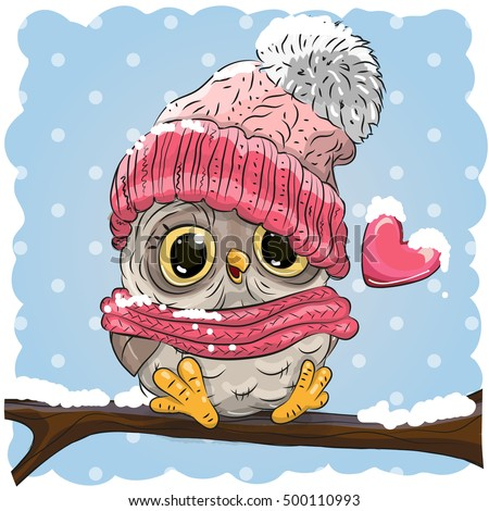 owl in a knitted cap sits on a