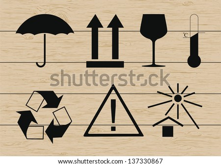 Packing symbols set on wooden background. Vector illustration