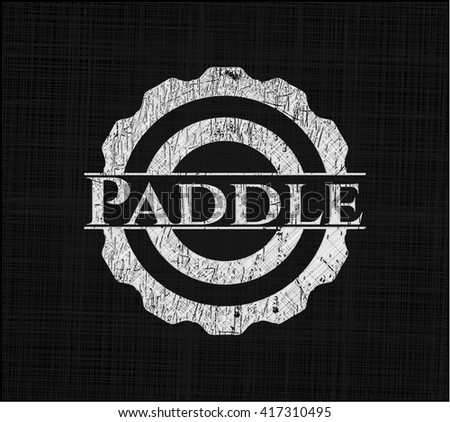 Paddle on chalkboard
