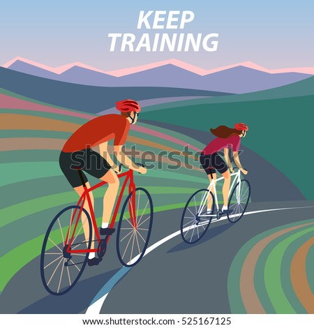pair of cyclists  riding on the