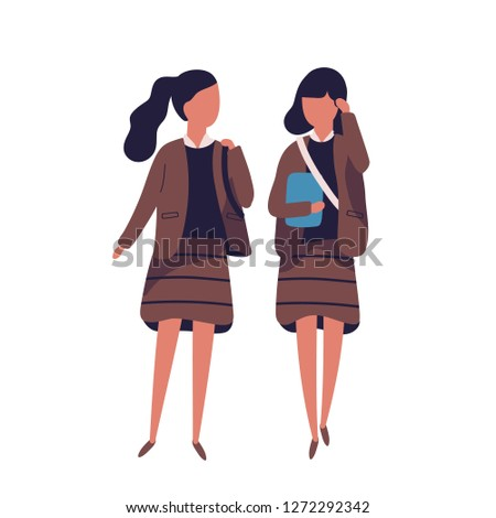 Pair of girls dressed in school uniform. Female students, pupils, classmates, schoolfellows walking together and talking to each other or chatting. Colored vector illustration in modern flat style.