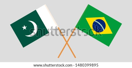 Pakistan and Brazil. Crossed Pakistani and Brazilian flags