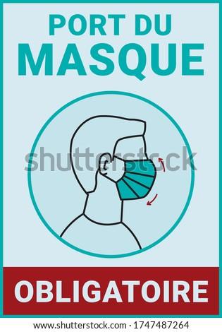 Pancarte d'affichage : Port du masque obligatoire. Covid-19. Translation: 'Wearing of mask is compulsory' Photo stock ©