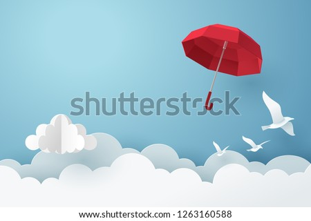 Paper art of red umbrella fly above the cloud on the sky, vector art and illustration.