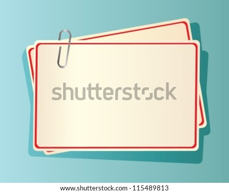 paper cards with red edging, fastened together with a staple in blue background
