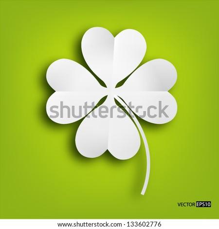 paper clover leaf on green