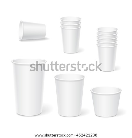 paper coffee cups on a white...