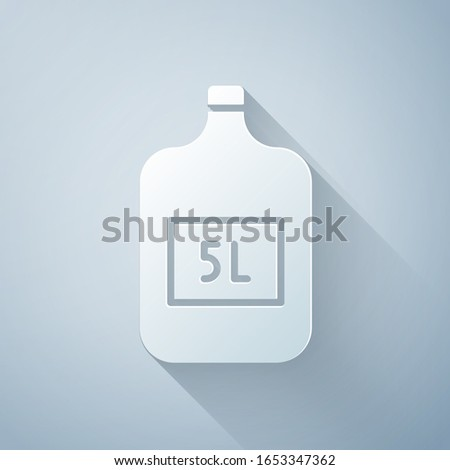 Paper cut Big bottle with clean water icon isolated on grey background. Plastic container for the cooler. Paper art style. Vector Illustration