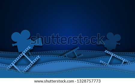 Paper cut cinema decorations with film strip frame isolated on blue background. 35 mm camera diapositive for design layout cinema. Template cinema with space for your text. Abstract paper art style.