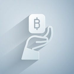 Paper cut Hand holding Bitcoin icon isolated on grey background. Blockchain technology, digital money market, cryptocoin wallet. Paper art style. Vector