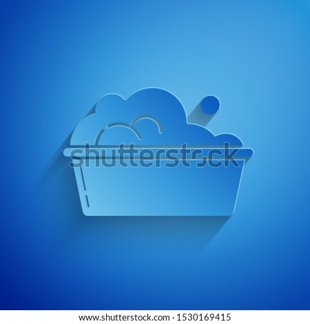 Paper cut Plastic basin with soap suds icon isolated on blue background. Bowl with water. Washing clothes, cleaning equipment. Paper art style. Vector Illustration