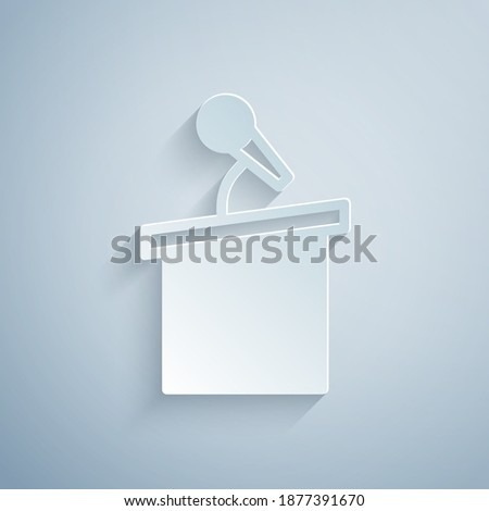 Paper cut Stage stand or debate podium rostrum icon isolated on grey background. Conference speech tribune. Paper art style. Vector. Stock photo ©