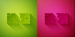 Paper cut Tearing apart money banknote into two peaces icon isolated on green and pink background. Paper art style. Vector