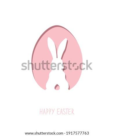 Paper easter egg shape with bunny silhouette. Easter rabbit inside egg. Easter greeting card.