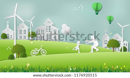 Stock Photo Paper folding art origami style vector illustration. Renewable energy ecology technology concepts, daughter is running to father and holding balloons in green meadow park which full of wind turbine.