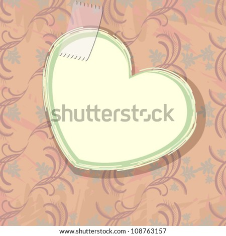 Paper heart over old wallpaper