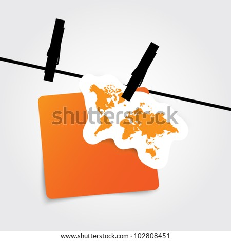 Paper label with world map on rope with clothes peg