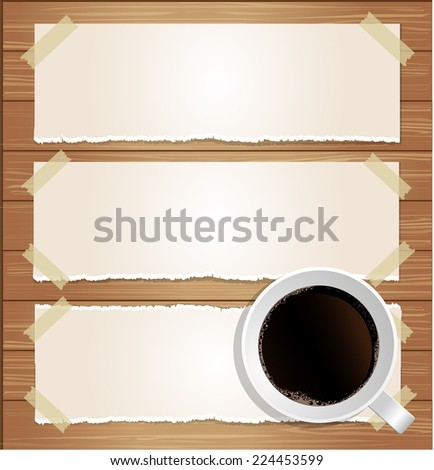 paper labels attached with sticky tape and coffee cup on wood background